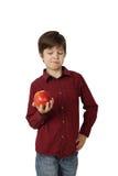 Niño pequeño con la manzana a disposición Fotos de archivo