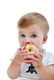 Niño pequeño con la manzana grande Foto de archivo