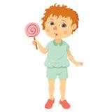 Niño pequeño con la piruleta Imagen de archivo libre de regalías