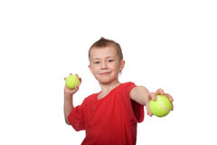 Niño pequeño con las bolas para el tenis Foto de archivo