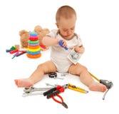 Niño pequeño con las herramientas Imagen de archivo libre de regalías