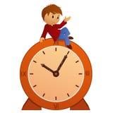 Niño pequeño de la historieta en el reloj del vintage Foto de archivo