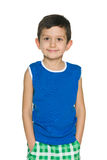 Niño pequeño de la moda en camisa azul Imagenes de archivo