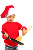 Niño pequeño del cocinero con el sartén Fotos de archivo libres de regalías