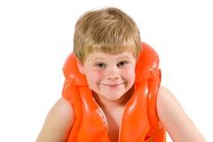Niño pequeño en chaleco de vida Foto de archivo libre de regalías
