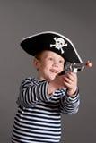 Niño pequeño en el juego del pirata Fotografía de archivo libre de regalías