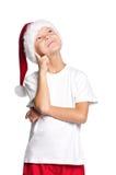 Niño pequeño en el sombrero de Santa Imagenes de archivo