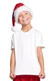 Niño pequeño en el sombrero de Santa Fotografía de archivo