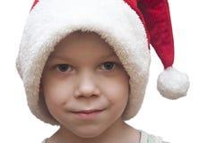 Niño pequeño en el sombrero rojo de santa Imágenes de archivo libres de regalías