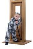 Niño pequeño en equipo del ladrón Imagen de archivo libre de regalías