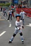 Niño pequeño en la raza Foto de archivo libre de regalías
