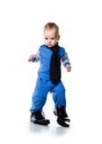 Niño pequeño en los zapatos grandes Imágenes de archivo libres de regalías