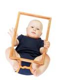 Niño pequeño en marco Fotos de archivo