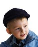 Niño pequeño en un casquillo imagenes de archivo