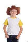 Niño pequeño en un casquillo del vaquero Fotografía de archivo