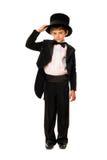 Niño pequeño en un smoking y un sombrero Foto de archivo