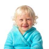 Niño pequeño feliz con la albornoz Imagen de archivo libre de regalías