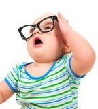 Niño pequeño lindo en vidrios Imagenes de archivo