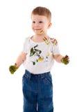 Niño pequeño manchado en pintura Imagenes de archivo
