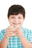 Niño pequeño que come un pan integral, emparedado Foto de archivo