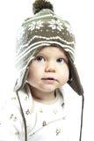 Pequeño niño en casquillo del invierno Imagen de archivo libre de regalías