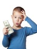 Niño pequeño que lleva a cabo dólares Imagen de archivo