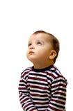 Niño pequeño que mira para arriba Foto de archivo libre de regalías