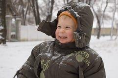 Niño pequeño rubicundo-hecho frente sonriente Imagenes de archivo