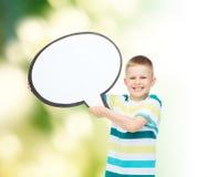 Niño pequeño sonriente con la burbuja en blanco del texto Foto de archivo libre de regalías