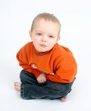 Niño pequeño triste en blanco Fotografía de archivo libre de regalías