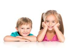 Niño pequeño y muchacha Fotos de archivo