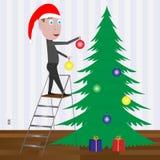 Niño que adorna el árbol de navidad con las bolas. Fotos de archivo