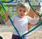 Niño que agita en el patio Fotografía de archivo