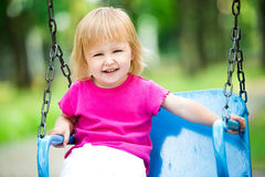 Niño que agita en el patio Imagen de archivo libre de regalías