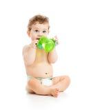 Niño que bebe de la botella Imagen de archivo