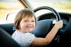 Niño que conduce el coche Fotos de archivo