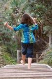 Niño que corre lejos Imagen de archivo libre de regalías