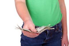 Niño que da el dinero Foto de archivo