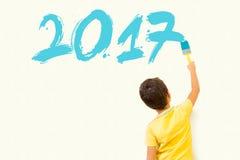 Niño que dibuja el Año Nuevo 2017 Fotografía de archivo
