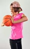 Niño que ejercita con una bola Imagen de archivo libre de regalías
