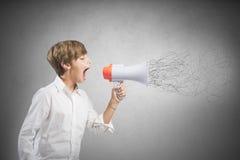Niño que grita en el megáfono Imágenes de archivo libres de regalías