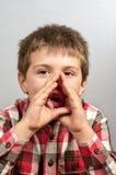 Niño que hace las caras feas 19 Imágenes de archivo libres de regalías