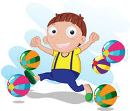 Niño que juega bolas Fotografía de archivo