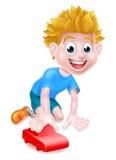 Niño que juega con el coche rojo Imagen de archivo