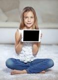 Niño que juega en la PC de la tableta Fotografía de archivo