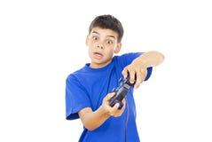 Niño que juega los juegos de ordenador en la palanca de mando Fotos de archivo libres de regalías