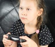Niño que juega a los juegos video Fotografía de archivo libre de regalías