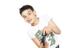 Niño que juega a los juegos video en la palanca de mando Foto de archivo libre de regalías