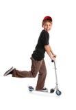 Niño que monta una vespa Imagen de archivo
