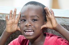Niño que pide perdón Imagenes de archivo